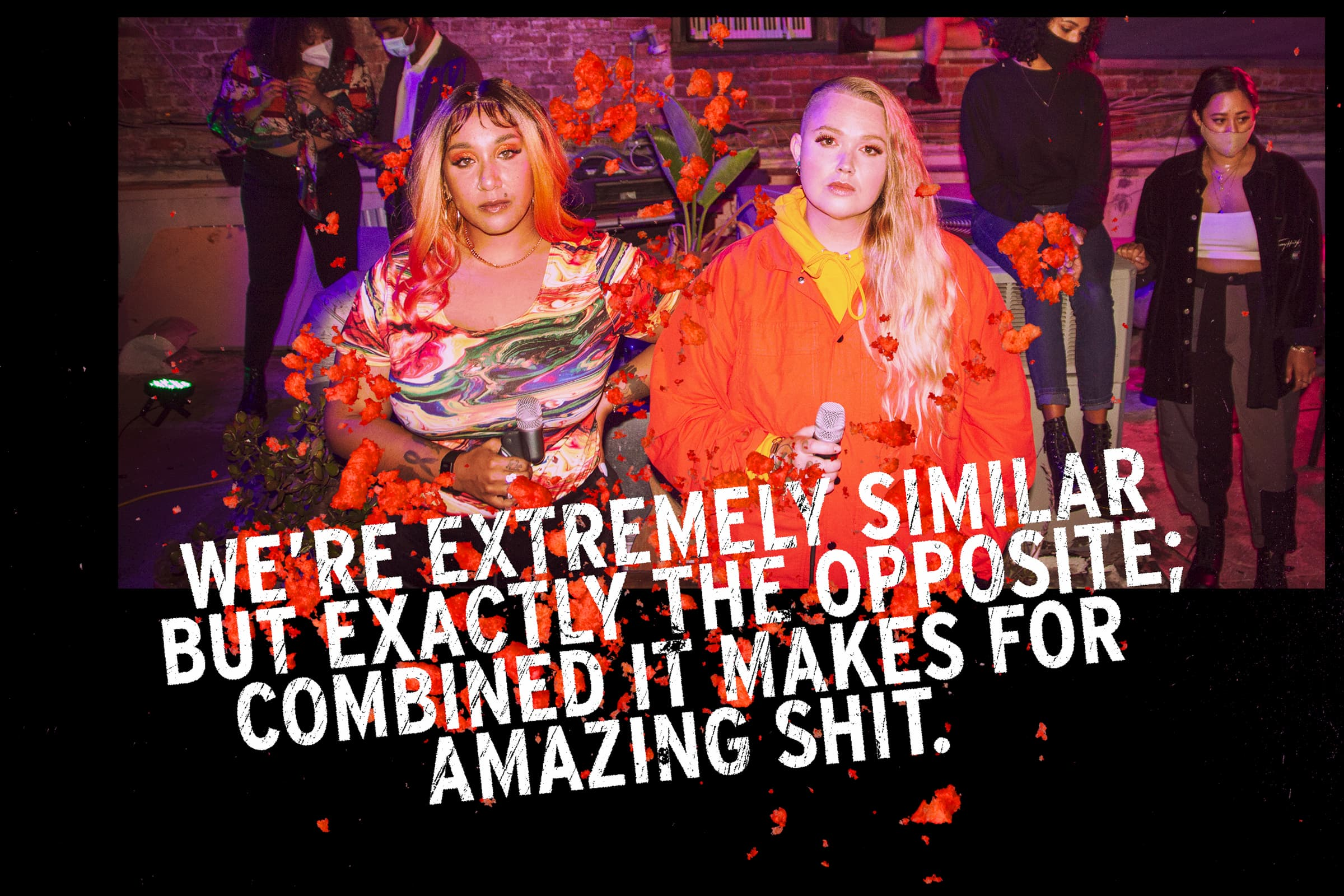 """A photo of Blimes & Gab looking directly into the camera with a confident look, they are holding microphones and are at an event. Overlaid are the words """"We're extremely similar but exactly the opposite; combined it makes for amazing shit."""""""