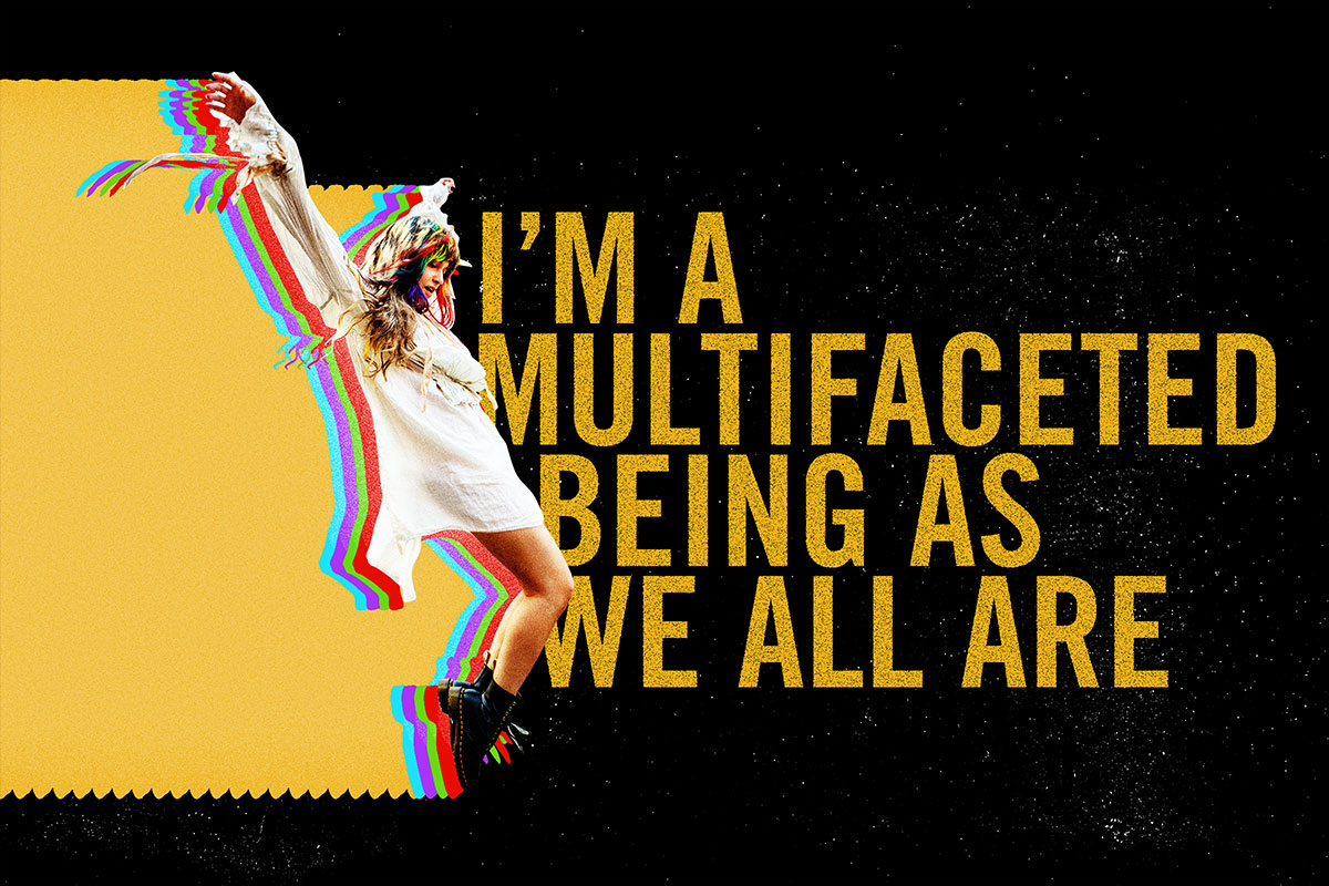 """Lauren standing on the point of her toes, with the words """"I'm a multifaceted being as we all are"""""""