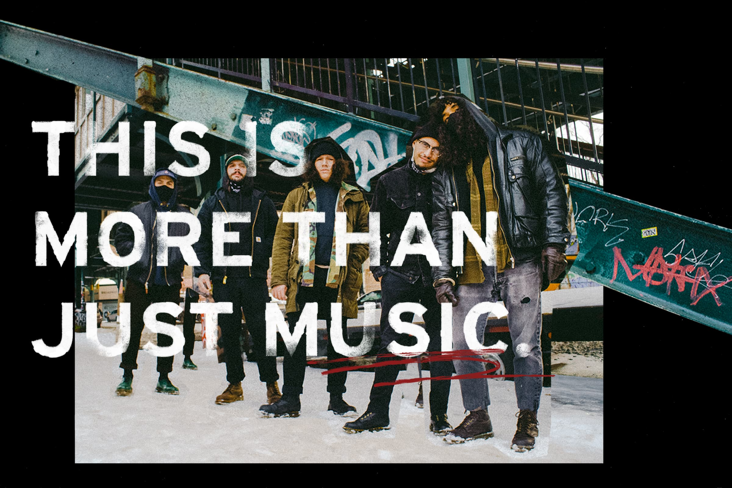 """The band Stuyedeyed posing in front of a tagged stairwell outside with text """"This is more than just music."""""""